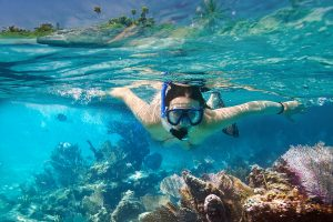 snorkeling 1 300x200 - Young women at snorkeling in the tropical water